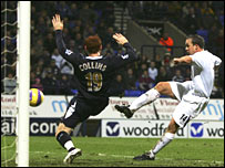 Kevin Davies (right) opens the scoring for Bolton