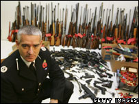 David Jones,  Assistant Chief Constable of Greater Manchester Police, with guns handed in during November's gun amnesty