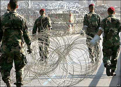 Lebanese special forces soldiers place barbed wire to secure the area around the Lebanese Government House.