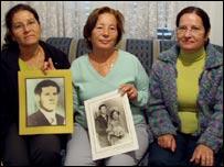 Emine Degirmencioglu and family holding wedding photos