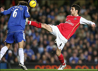 Ricardo Carvalho is challenged by Cesc Fabregas