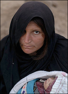 Mother Jan Bibi with her surviving twin Merzia in Syakamarak village.
