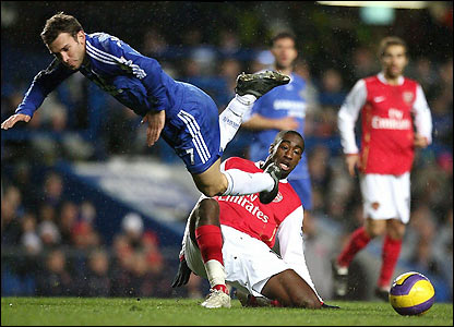Chelsea's Andriy Shevchenko is tackled by Johan Djourou