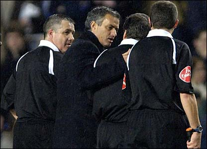 Jose Mourinho chats to referee Alan Wiley