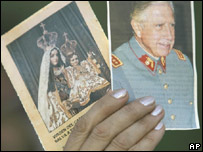 A supporter holds an image of the late Gen Pinochet