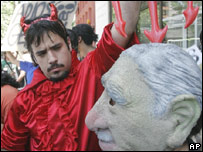 Opponents of former dictator Gen Augusto Pinochet protest outside the hospital where he died