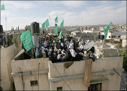 Women gather on the roof of a house in Beit Lahiya to act as human shields