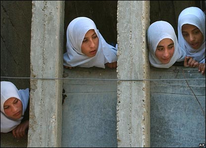 Women peer out of balcony of threatened building in Beit Lahiya, Gaza