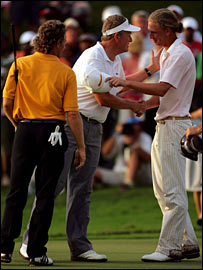 Colin Montgomerie congratulates Marcel Siem while Bernhard Langer looks on