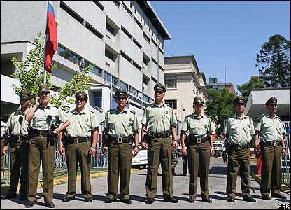Military police on guard outside the Santiago military hospital