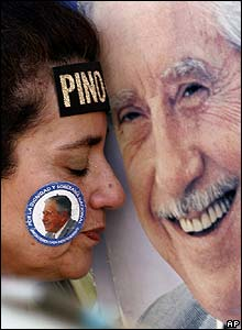 A woman mourns the death of Gen Augusto Pinochet