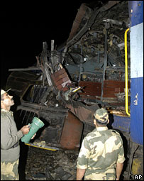 Police inspect a compartment after a bomb explosion in a train, near Belakova in West Bengal