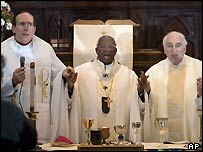 Archbishop Emmanuel Milingo ordaining the two married priests