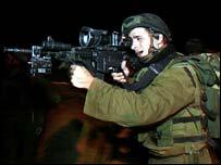 Israeli soldier checks rifle [21 November]