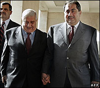 Syrian FM Walid Muallim (left) and his Iraqi counterpart Hoshyar Zebari