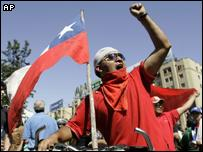 An opponent of Augusto Pinochet celebrates his death in Santiago, Chile