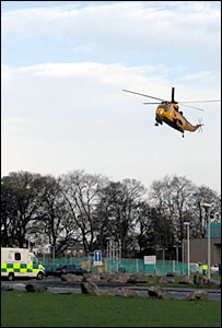 RAF helicopter arrives at Raigmore Hospital in Inverness with the second climber