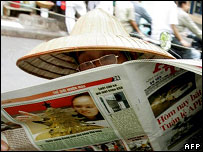 Man in Hanoi reads a state newspaper