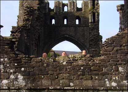 Richard Ford and two friends peeping over a wall at Llanthony priory.