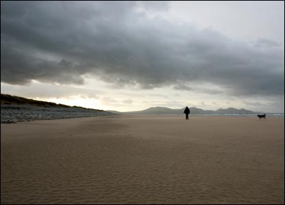 Iolo Penri's partner Jan walking on Dinas Dinlle beach