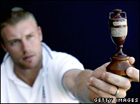 England captain Andrew Flintoff holds a replica of the Ashes urn