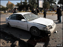The wreckage of a car at the site where a roadside bomb exploded near central Baghdad