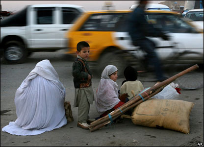 A mother and her children sit on the roadside in Kabul, Afghanistan