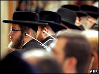 Members of a Jewish group listen to the conference speeches