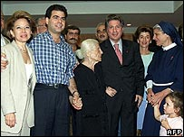 Pierre (2nd left) greets his returning father at Beirut airport in 2000