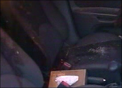 The bloody seats inside the car (television grab)