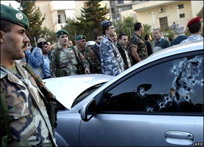 The side window of Pierre Gemayel's car, riddled with bullets (television grab)
