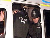 Mr Oliver in a police van