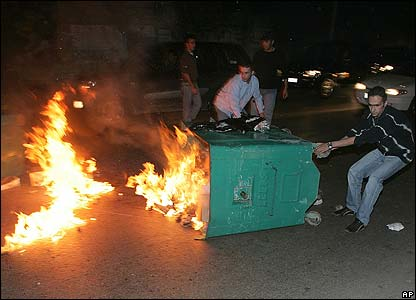 Angry Pierre Gemayel supporters burn a rubbish bin in Beirut