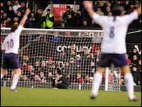 Robbie Keane and Pedro Mendes of Spurs appeal for a goal after the ball crosses the line during the Premiership match between Manchester United and Tottenham Hotspur at  Old Trafford
