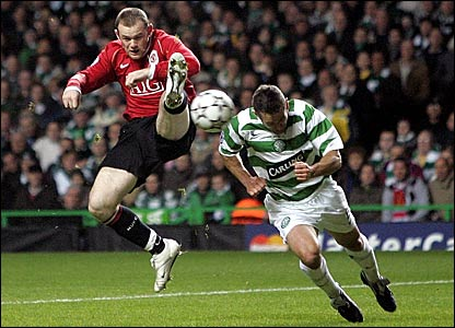Manchester United's Wayne Rooney beats Celtic's Paul Telfer to the ball
