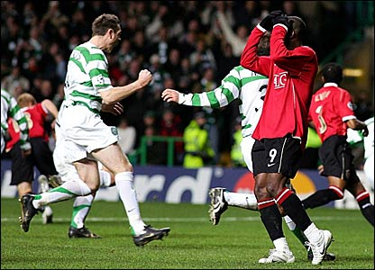 Manchester United striker Louis Saha (right) reacts after seeing his penalty saved