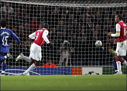 Julio Baptista (centre) scores Arsenal's third goal