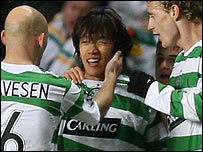 Shunsuke Nakamura celebrates with his team-mates