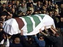Supporters carry Pierre Gemayel's coffin