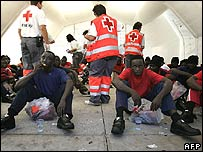 Illegal migrants and Red Cross workers on the Spanish Canary Island of Tenerife