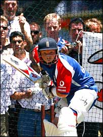 Fans watch England batsman Ian Bell in the nets
