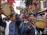 Nepalese people sing and dance in a victory march