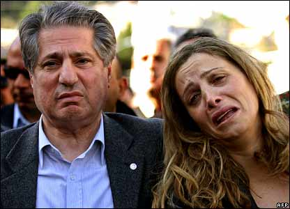 Former Lebanese president Amin Gemayel (L), father, and Patricia Daif, the murdered minister's wife, walk in front his coffin