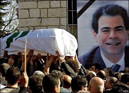 Lebanese mourners carry the coffin of assassinated Industry Minister Pierre Gemayel (portrait) through the Gemayels' hometown Bikfaya, in the mountains north-east of Beirut