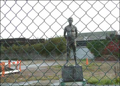 The Jim Driscoll statue in Cardiff, fenced off because of building work (sender unknown)