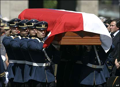 Honour Guard soldiers carry the coffin of Chile's former military ruler Augusto Pinochet