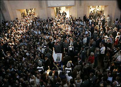 Crowds of family and supporters attend Gen Pinochet's wake attend the wake of his father at the Military Academy in Santiago (11 December)
