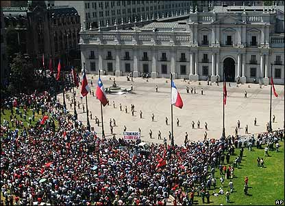 Opponents of Gen Pinochet gather in front of the presidential palace in Santiago