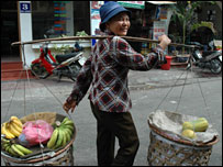 Nguyen Thi Ha carrying her wares