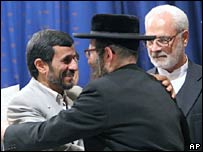 Iranian President Mahmoud Ahmadinejad (left) shakes hands with an anti-Zionist rabbi in Tehran